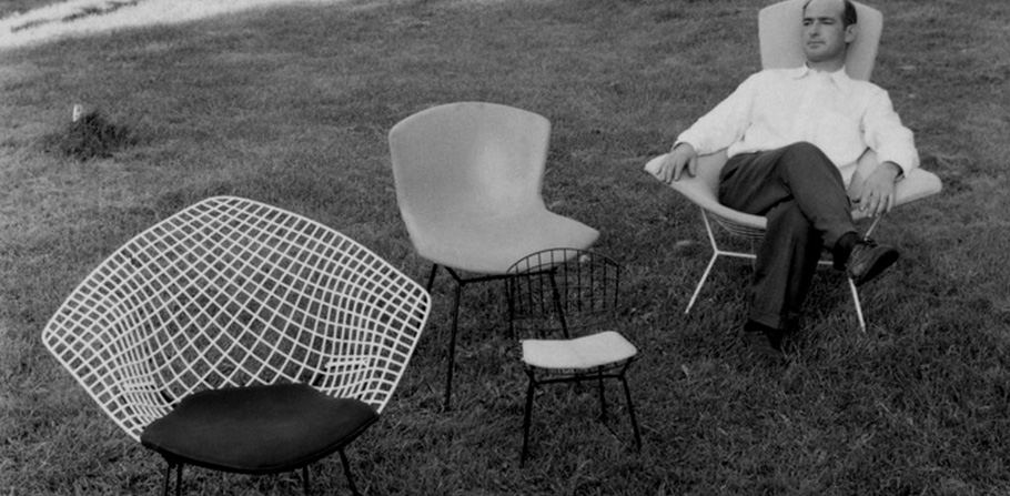 Harry Bertoia relaxing with a selection of his chair designs