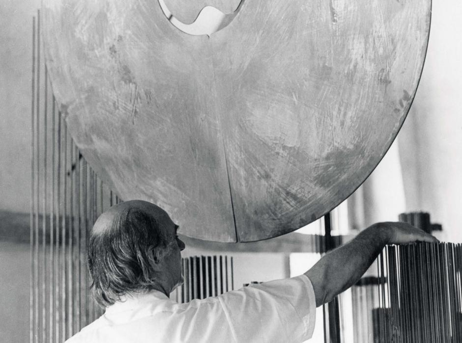 Harry Bertoia sounding his sculptures, 1973