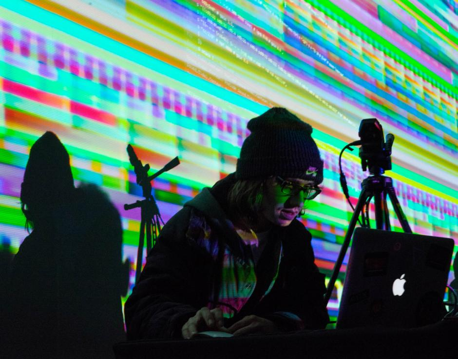 Tich offmenut performs at the Algorave with visuals by hellocatfood. Photo by James Vanderhoven